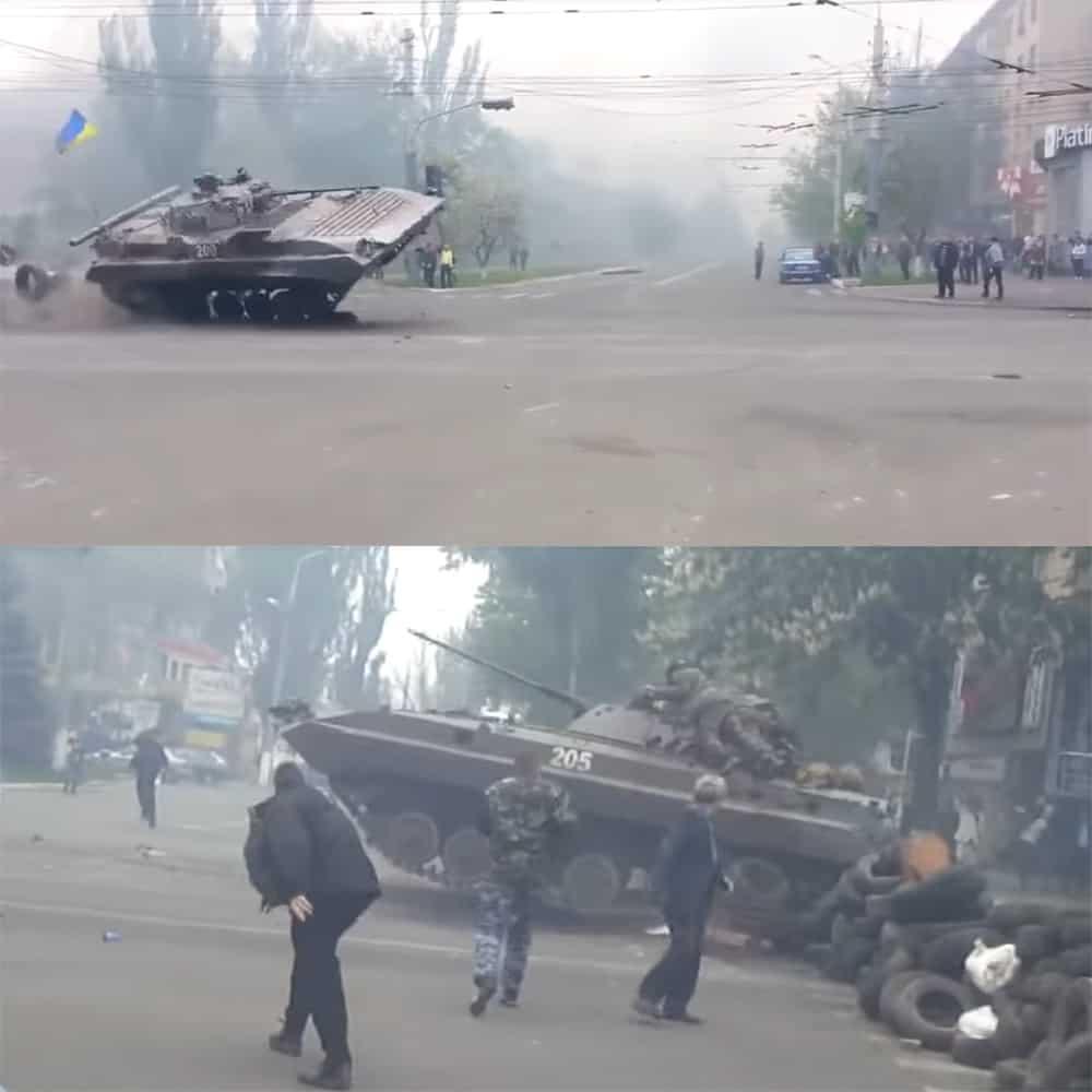 Українські БМП долають барикаду на перехресті навпроти міськради під час виходу з міста. Зверху: БМП № 200. Знизу: БМП №205 несе солдат на броні.