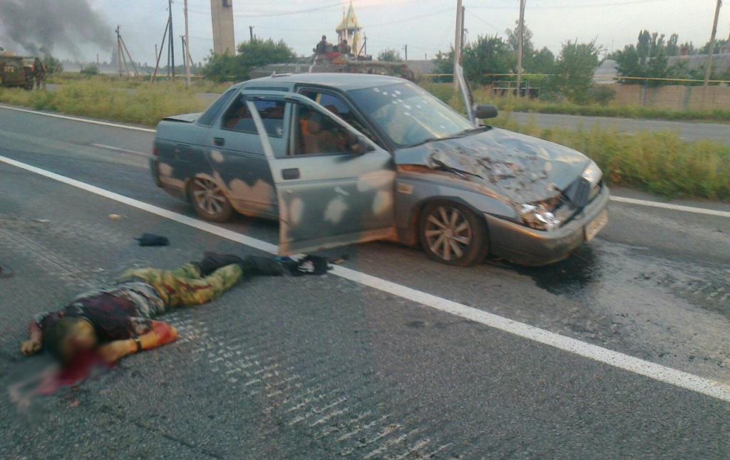 Убитый террорист и расстрелянная машина (с колесами)